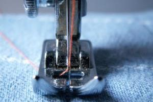 Close-up on a sewing machine in action